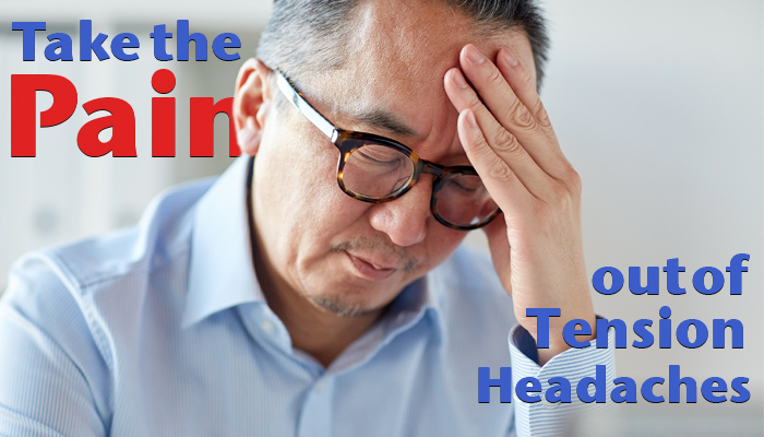 Man holding his head suffering from a tension headache.