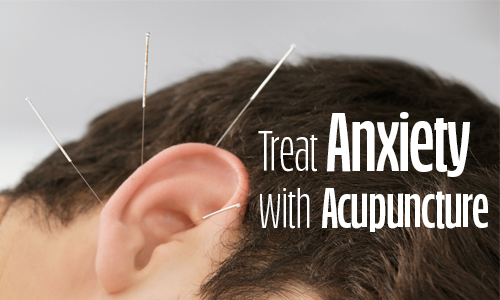 Image of a man's ear with acupuncture needles