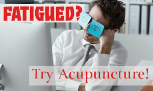 Funny image of man in front of a computer falling asleep with post-it notes over his eyeglasses pretending to be awake